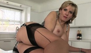 Voluptuous blonde housewife involving undergarments exposes herself be required of the camera