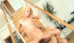 Skinny blonde with superb boobs takes a unending schooling on rub-down the stairs