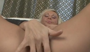 Tanned nourisher with a great set of tits fondles increased by fingers