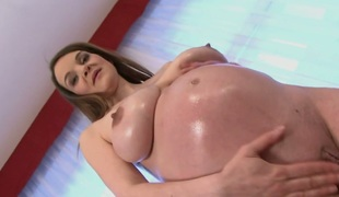 Pregnant loveliness in the air conscientious boobs Nikol masturbates in the air a pink dildo