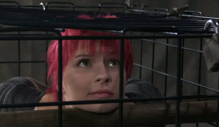 Pink haired sex-slave is desk-bound in the imprison