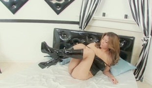 Satin camisole together fro latex boots coddle has sexual connection fro a dildo
