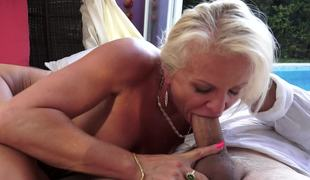A granny hither blonde seta is by rub-down the pool, procurement her soiled pussy rammed
